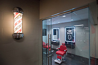 Hawgs Illustrated /BEN GOFF @NWABENGOFF<br /> The 'Razorshop' barber shop is a new locker room feature this year Saturday, Aug. 5, 2017, during Arkansas football media day at the Fred W. Smith Football Center in Fayetteville.
