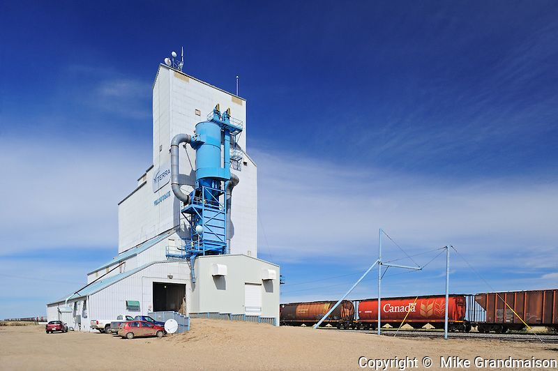 Grain elevator and trains<br /> Yellow Grass<br /> Saskatchewan<br /> Canada