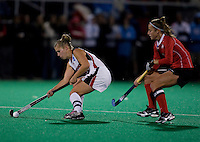 Katie O'Donnell (16) of Maryland takes control of the ball in front of Bri Doak (3) of Ohio State during the NCAA Field Hockey Championship semfinals in College Park, MD.  Maryland defeated Ohio State, 3-1.