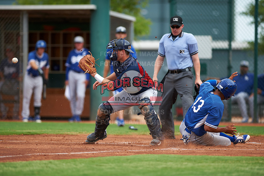 Cleveland Indians Jack Goihl (9) waits for a throw as Jared Walker (13) slides in safely during an instructional league game against the Los Angeles Dodgers on October 15, 2015 at the Goodyear Ballpark Complex in Goodyear, Arizona.  (Mike Janes/Four Seam Images)