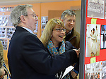 Phil Nulty, former club member Lorraine O'Neill and her husband Max Lawlor  looking at  photos at the exhibition to commemorate 45 years of the Drogheda Karate Club held in the Barbican Centre. Photo:Colin Bell/pressphotos.ie