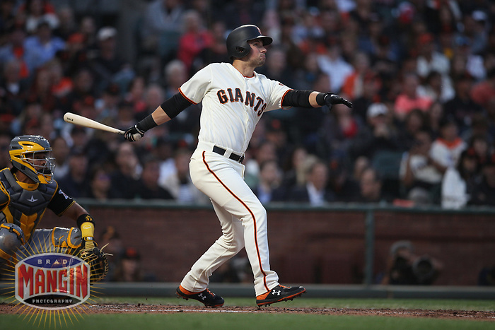 SAN FRANCISCO, CA - AUGUST 11:  Joe Panik #12 of the San Francisco Giants bats against the Pittsburgh Pirates during the game at AT&T Park on Saturday, August 11, 2018 in San Francisco, California. (Photo by Brad Mangin)