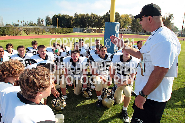 Culver City, CA 09/16/10 - Coach Brian Hults and the Peninsula Panthers team at halftime.