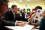 Congressman-elect Jim Bridenstine, from Oklahoma's First District, center, makes decisions about his future office, with his chief of staff Joe Kaufman, left, and architect Bruce Arthur, right, in the Rayburn House Office Building in Washington, DC on Nov. 30, 2012.