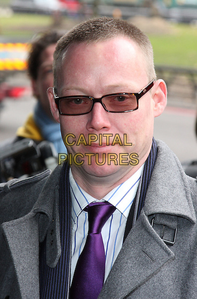 RICKY GROVES .The TRIC Awards 2010 (Television and Radio Industries Club) held at the Grosvenor House Hotel, Park Lane, London, England..March 9th 2010.headshot portrait purple tie sunglasses shades grey gray .CAP/ROS.©Steve Ross/Capital Pictures.