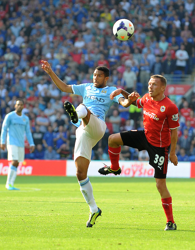 Cardiff City's Craig Bellamy and Manchester City's Gael Clichy challenge for the header <br /> <br /> Photo by Ian Cook/CameraSport<br /> <br /> Football - Barclays Premiership - Cardiff City v Manchester City - Sunday 25th August 2013 - Cardiff City Stadium - Cardiff<br /> <br /> &copy; CameraSport - 43 Linden Ave. Countesthorpe. Leicester. England. LE8 5PG - Tel: +44 (0) 116 277 4147 - admin@camerasport.com - www.camerasport.com