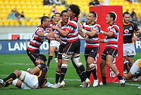 Counties-Manukau players congratulate Reynold Lee-Lo on his try. ITM Cup - Wellington Lions v Counties-Manukau Steelers at Westpac Stadium, Wellington, New Zealand on Sunday, 8 August 2010. Photo: Dave Lintott/lintottphoto.co.nz.