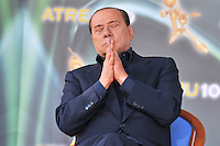 Italy's Prime Minister Silvio Berlusconi attends a youth meeting in Rome on September 12, 2010.