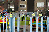 Police question young men in a play area on West Kensington Estate, Hammersmith & Fulham, which the council proposes to sell and demolish, together with neighbouring Gibbs Green Estate.