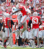 Ohio State Buckeyes defensive lineman Steve Miller (88) celebrates his sack of  San Diego State Aztecs quarterback Quinn Kaehler (18)(not in with) with co-defensive coordinator Luke Fickell during the 1st quarter of their college football game at Ohio Stadium in Columbus on September 7, 2013.  (Dispatch photo by Kyle Robertson)