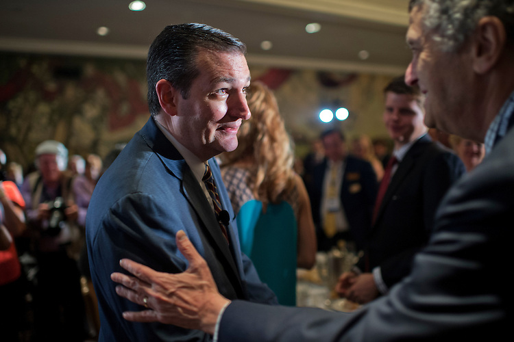 UNITED STATES - JUNE 18: Sen. Ted Cruz, R-Texas, greets guests at the Faith & Freedom Coalition's Road to Majority conference which featured speeches by conservative politicians at the Omni Shoreham Hotel, June 18, 2015. (Photo By Tom Williams/CQ Roll Call)