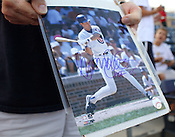 David Tuttle, of Chapel Hill shows off an autograph of Lehigh Valley IronPigs manager and former Chicago Cubs star Ryne Sandberg before the Durham Bulls vs. Lehigh Valley baseball game on Thursday, August 4, 2011. Lehigh won 5-3. Photo by Al Drago.