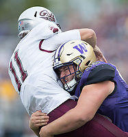 Greg Gaines pounds Montana quarterback Reese Phillips.