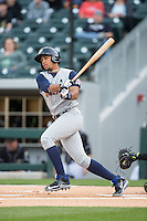 Dixon Machado (28) of the Toledo Mud Hens follows through on his swing against the Charlotte Knights at BB&T BallPark on April 27, 2015 in Charlotte, North Carolina.  The Knights defeated the Mud Hens 7-6 in 10 innings.   (Brian Westerholt/Four Seam Images)