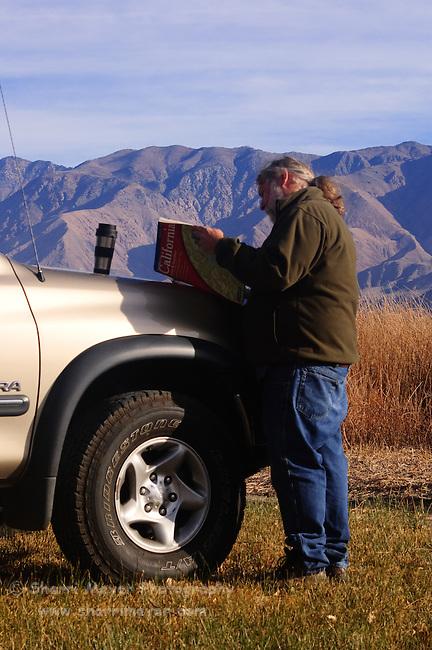 Man reading the Northern California Atlas & Gazetteer