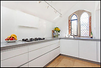 BNPS.co.uk (01202 558833)<br /> Pic:   Charters/BNPS<br /> <br /> Just divine ...<br /> <br /> A stunning converted chapel which has been transformed into a modern family home has emerged on the market for £800,000.<br /> <br /> Grade II listed The Old Chapel, in the hamlet of Pitt on the outskirts of Winchester, Hants, was built 170 years ago.<br /> <br /> It was a church up until the late 1990s when it was turned into a recording studio, and subsequently into a home.<br /> <br /> The present owners purchased the property ten years ago and have spent £250,000 renovating its interior, giving it a contemporary feel.