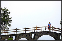 A mother and her two sons stand on a bridge near Currituck Lighthouse in Corolla, N.C.. Bridge is located in the Outer Banks of North Carolina. Model released image, can be used to illustrate many purposes.