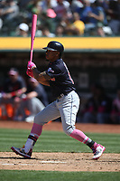 OAKLAND, CA - MAY 12:  Francisco Lindor #12 of the Cleveland Indians bats against the Oakland Athletics during the game at the Oakland Coliseum on Sunday, May 12, 2019 in Oakland, California. (Photo by Brad Mangin)