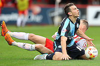 Tom Conlon of Stevenage and Matt Bloomfield of Wycombe Wanderers in action during the Sky Bet League 2 match between Stevenage and Wycombe Wanderers at the Lamex Stadium, Stevenage, England on 17 October 2015. Photo by PRiME Media Images.