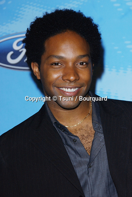 Brandon Rogers arriving at the AMERICAN IDOL, The Top 12 Final Contestants at the Astra Restaurant  in Los Angeles.<br /> <br /> headshot<br /> smile<br /> eye contact