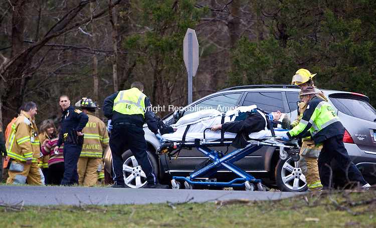WOODBURY, CT - 23 MARCH 2010 -032310JT03-<br /> A patient is wheeled to an ambulance after an accident involving three vehicles at the intersection of Route 64 and Middle Quarter Road in Woodbury on Tuesday afternoon.<br /> Josalee Thrift Republican-American
