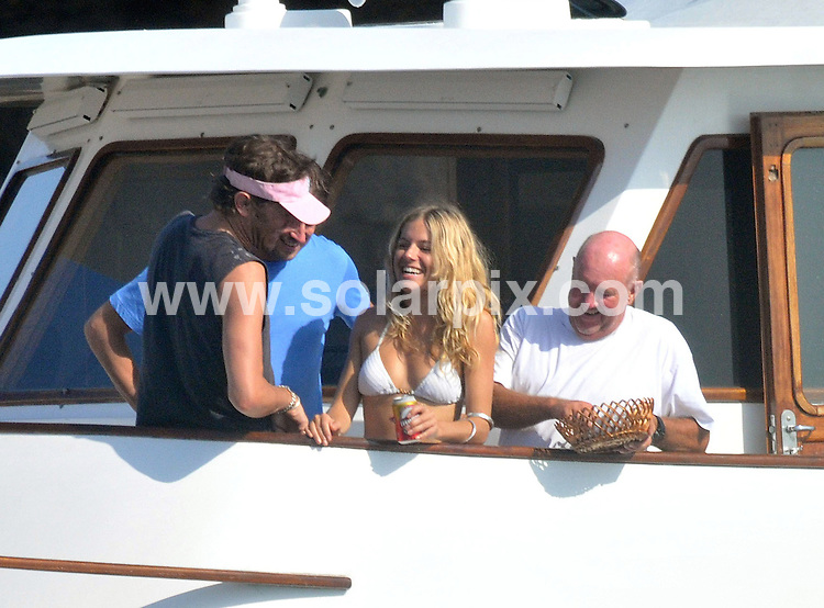 **ALL ROUND PICTURES FROM SOLARPIX.COM**.**WORLDWIDE SYNDICATION RIGHTS APART FROM SPAIN - NO SYNDICATION IN SPAIN**.Sienna Miller & new boyfriend George Barker enjoying the sunshine on board a boat off the island of Ibiza..This pic:       Sienna Miller & new boyfriend George Barker.JOB REF:    9761         RMJ       DATE: 13.08.09.**MUST CREDIT SOLARPIX.COM OR DOUBLE FEE WILL BE CHARGED**.**MUST NOTIFY SOLARPIX OF ONLINE USAGE**.**CALL US ON: +34 952 811 768 or LOW RATE FROM UK 0844 617 7637**
