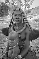 Himba lady and her baby in remote Kaokoland, Namibia