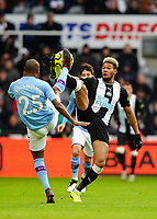 30th November 2019; St James Park, Newcastle, Tyne and Wear, England; English Premier League Football, Newcastle United versus Manchester City; Joelinton of Newcastle United and Fernandinho of Manchester City compete for the high ball - Strictly Editorial Use Only. No use with unauthorized audio, video, data, fixture lists, club/league logos or 'live' services. Online in-match use limited to 120 images, no video emulation. No use in betting, games or single club/league/player publications