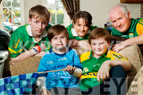 Sean Kearney pictured in his Dublin football jersey with his family: From left: Michael Sean Treacy, Jack and John Kearney.