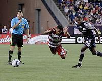 FC Dallas forward David Ferreira(10) is tackled by New England Revolution midfielder Joseph Niouky (23).  The New England Revolution drew FC Dallas 1-1, at Gillette Stadium on May 1, 2010