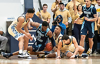 WASHINGTON, DC - FEBRUARY 8: Cyril Langevine #10 of Rhode Island clashes with Ace Stallings and Adam Mitola #5 of George Washington on the floor during a game between Rhode Island and George Washington at Charles E Smith Center on February 8, 2020 in Washington, DC.