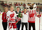 Wisconsin Badgers senior Kelly Jaminksi (7) is recognized on Senior Night with her mother and brothers during an NCAA college women's hockey game against the Minnesota Golden Gophers Friday, February 14, 2014 in Madison, Wis. The Golden Gophers won 3-2. (Photo by David Stluka)