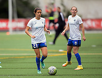 Seattle, Washington - Saturday May 14, 2016:  Seattle Reign FC defender Michelle Cruz (21) and forward Manon Melis (14) during warmups at Memorial Stadium on Saturday May 14, 2016 in Seattle, Washington. The match ended in a 1-1 draw