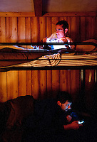 OutdoorLife Editor Andrew McKean (cq) Web Editor for Ducks Unlimited Chris Jennings (cq) prepare for bed at the Crazy Woman Lodge in Superior, Nebraska, Wednesday, November 30, 2011. ..Photo by Matt Nager