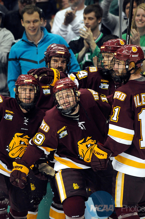 09 APR 2011: University of Minnesota Duluth players celebrate Max Tardy's (19) second period goal against the Michigan Wolverines in the second period during the Division I Men's Ice Hockey Championship held at the Xcel Energy Center in St. Paul, MN. Minnesota-Duluth beat Michigan in overtime, 3-2 to claim the national title. Vince Muzik/ NCAA Photos