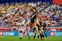 HARRISON, NJ - SEPTEMBER 29: Erica Skroski #8 of Sky Blue FC goes up for a header with Alanna Kennedy #14 and Ali Krieger #11 of the Orlando Pride during a game between Orlando Pride and Sky Blue FC at Red Bull Arena on September 29, 2019 in Harrison, New Jersey.