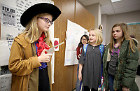 NWA Democrat-Gazette/DAVID GOTTSCHALK  Nadia Smith (from right) and Madison Wantland, both fourth grade students, look at Laci Kyle, a fifth grade student, as she portrays a wax figure of Billy the Kid in front of her exhibit Friday, March 16, 2018, during the Career Fair Day at Lincoln Middle School. The fair featured representatives from 20 job fields visiting classrooms, the wax museum and student grant proposals for funding of school improvement projects.