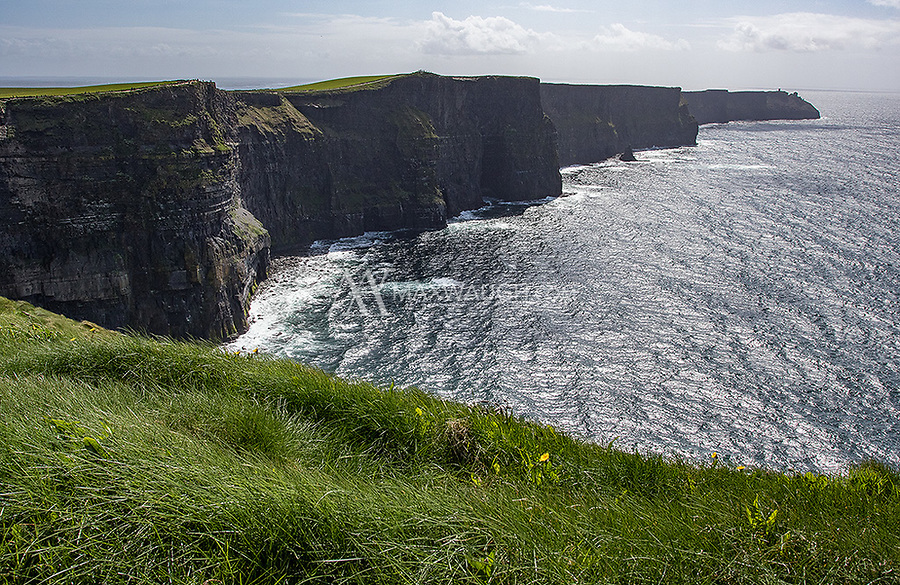 The Cliffs of Moher tower above the Atlantic Ocean.