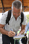 Stephen Roche (IRL) signs autographs before the start of  Stage1 of the 2009 Tour of Ireland, running 196km from the Ritz-Carlton Hotel Powerscourt, Enniskerry to Waterford, Ireland. 21st August 2009.<br /> (Photo by Eoin Clarke/NEWSFILE)