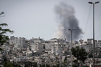 Smoke rises during an aircraft strike over the majority-Kurdish Sheikh Maksoud district as the Syrian army continues its operation to sweep out the neighborhood from opposition fighters who entered into the Kurdish area since weeks ago, forcing thousands of residents to flee into safe areas outside of Aleppo City.