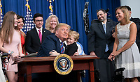 United States President Donald J. Trump hugs Jordan McLinn after signing S. 204, the &ldquo;Right to Try Act&rdquo; at the White House in Washington, DC, May 30, 2018.<br /> CAP/MPI/RS<br /> &copy;RS/MPI/Capital Pictures