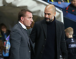 Brendan Rogers manager of Celtic and Josep Guardiola manager of Manchester City during the Champions League Group C match at the Etihad Stadium, Manchester. Picture date: December 6th, 2016. Pic Simon Bellis/Sportimage
