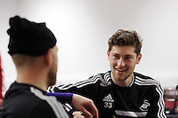 Wednesday, 23 April 2014<br /> Pictured: Ben Davies (R) in the breakfast room.<br /> Re: Swansea City FC are holding an open training session for their supporters at the Liberty Stadium, south Wales,