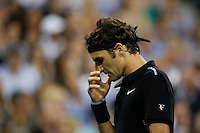 Roger Federer of Switzerland reacts after hitting a return to Gael Monfils of France during their quarter-final game at the US Open 2014 tennis tournament at the USTA Billie Jean King National Center in New York.  09.04.2014. VIEWpress
