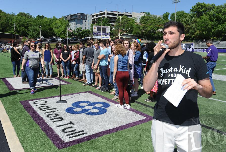 NWA Democrat-Gazette/ANDY SHUPE<br /> Kikko Haydar, a former Fayetteville High School and University of Arkansas student-athlete, serves as emcee Friday, May 5, 2017, during the ninth annual Moving Up ceremony at Harmon Stadium at the school. After recognitions for group and team achievements, seniors are given the opportunity to speak to their teachers as they leave the school for the final time. Members of the freshman, sophomore and junior classes then move up ceremoniously to the next grade level.