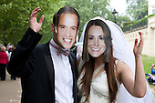 The Royal Wedding of HRH Prince William to Kate Middleton. Spectators in the Mall wearing royal masks.