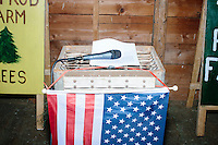A microphone stands on a podium with an American flag before satirical presidential candidate Vermin Supreme speaks at Ten Rod Farm in Rochester, New Hampshire. Supreme's platform advocates a pony-based economy, using zombies to solve the energy crisis, and other outlandish ideas. Supreme has been on the New Hampshire primary ballot in 2008 and 2012, though he has been running for president in 1992. Vermin Supreme will be on the Democratic party ballot in the 2016 New Hampshire primary.