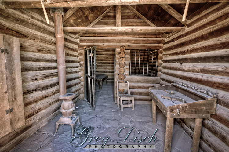 Next door to the Road Kill Cafe in Seligman Arizona is the old Arizona Territorial jail whose walls once corralled such notorious outlaws as: <br /> <br /> Seligman Slim <br /> Four-Fingered Frank <br /> Carl &ldquo;Curly&rdquo; Bane <br /> <br /> Adjacent to the jail are the Old West storefronts which have been used as a background for many commercials as well as documentaries.