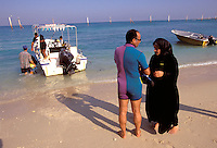© Caroline Penn / Panos Pictures..Iranian women in sport..Kish Island, Iran. October 1999...Husband and wife preparing to go on a scuba diving lesson together.