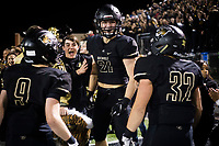 NWA Democrat-Gazette/CHARLIE KAIJO Bentonville High School Harrison Campbell (21) reacts with teammates after a 31-7 victory during a football game, Friday, November 2, 2018 at Bentonville High School in Bentonville.